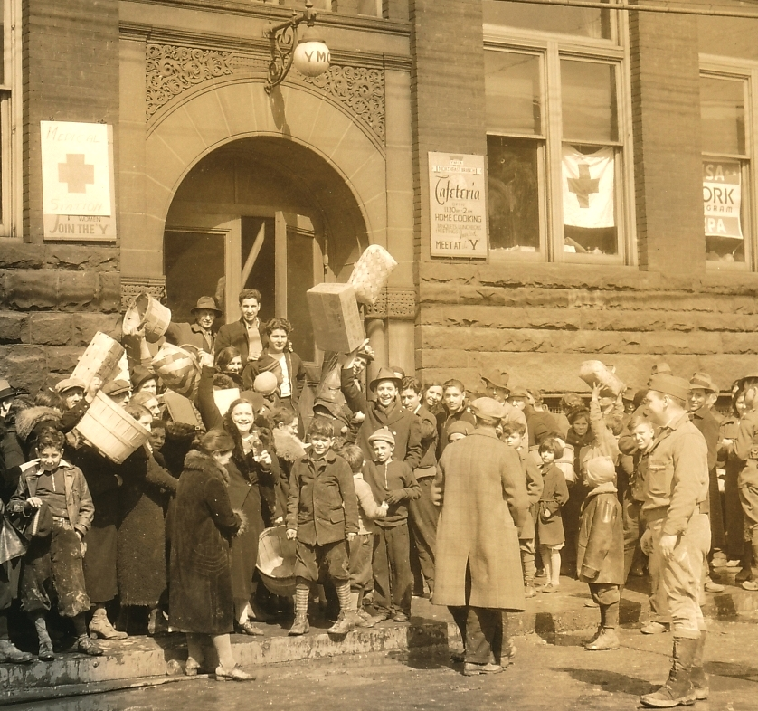 Survivors of a flood in Sharpsburg, Pennsylvania are relieved to find emergency help at a WPA and YMCA station. Photo courtesy of the National Archives (1936).