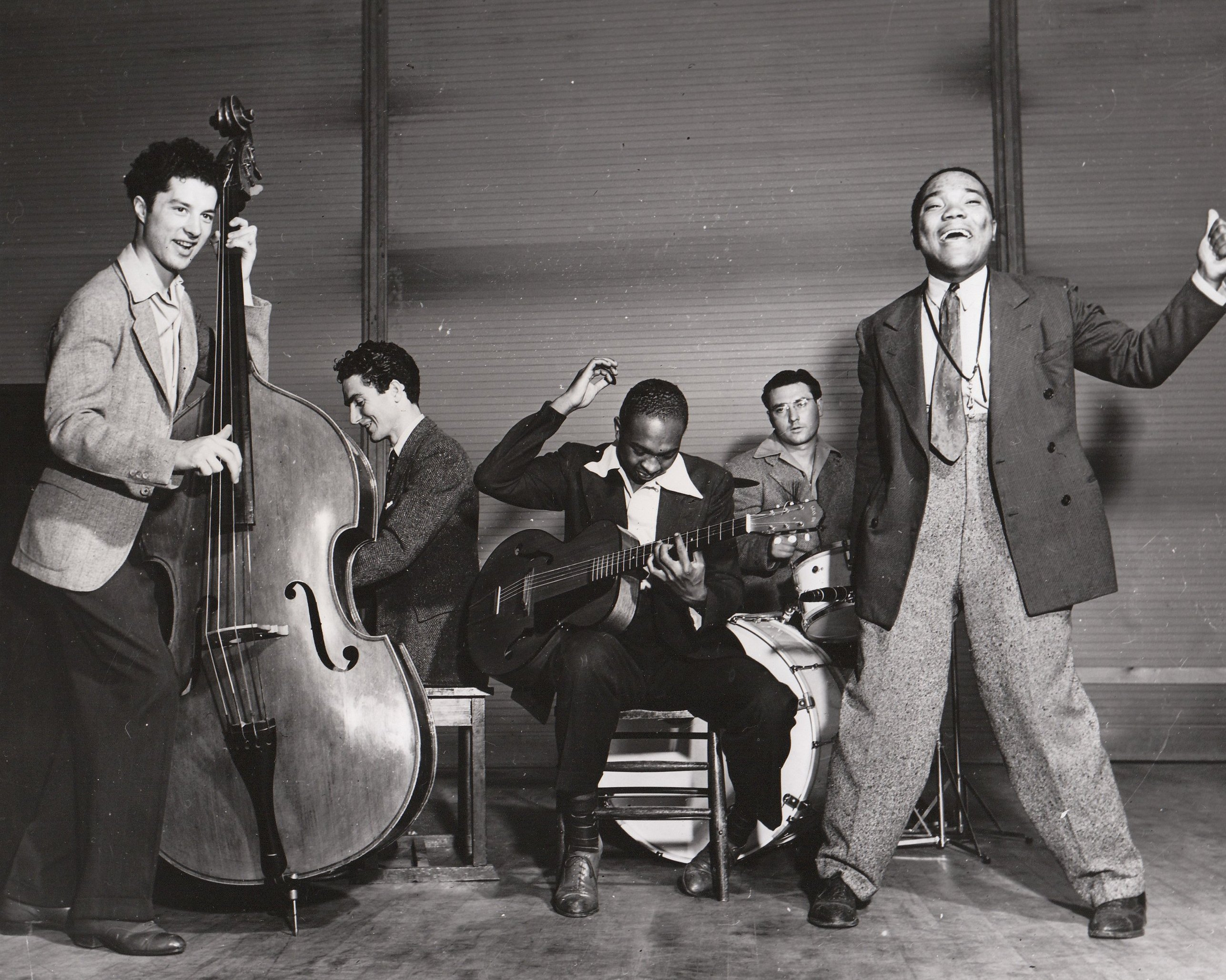 (left to right) Lee Cretarolo, Paul Dunlap, Hall Brant, Jimmy Pulara, and Terry Cruse are glad to make music in an NYA band for their fellow Los Angeles residents. Photo courtesy of the National Archives (ca. 1935-1943).