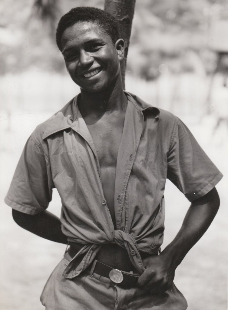A young Puerto Rican man, happy to have a job in the National Youth Administration. Photo courtesy of the National Archives (ca. 1935-1943).