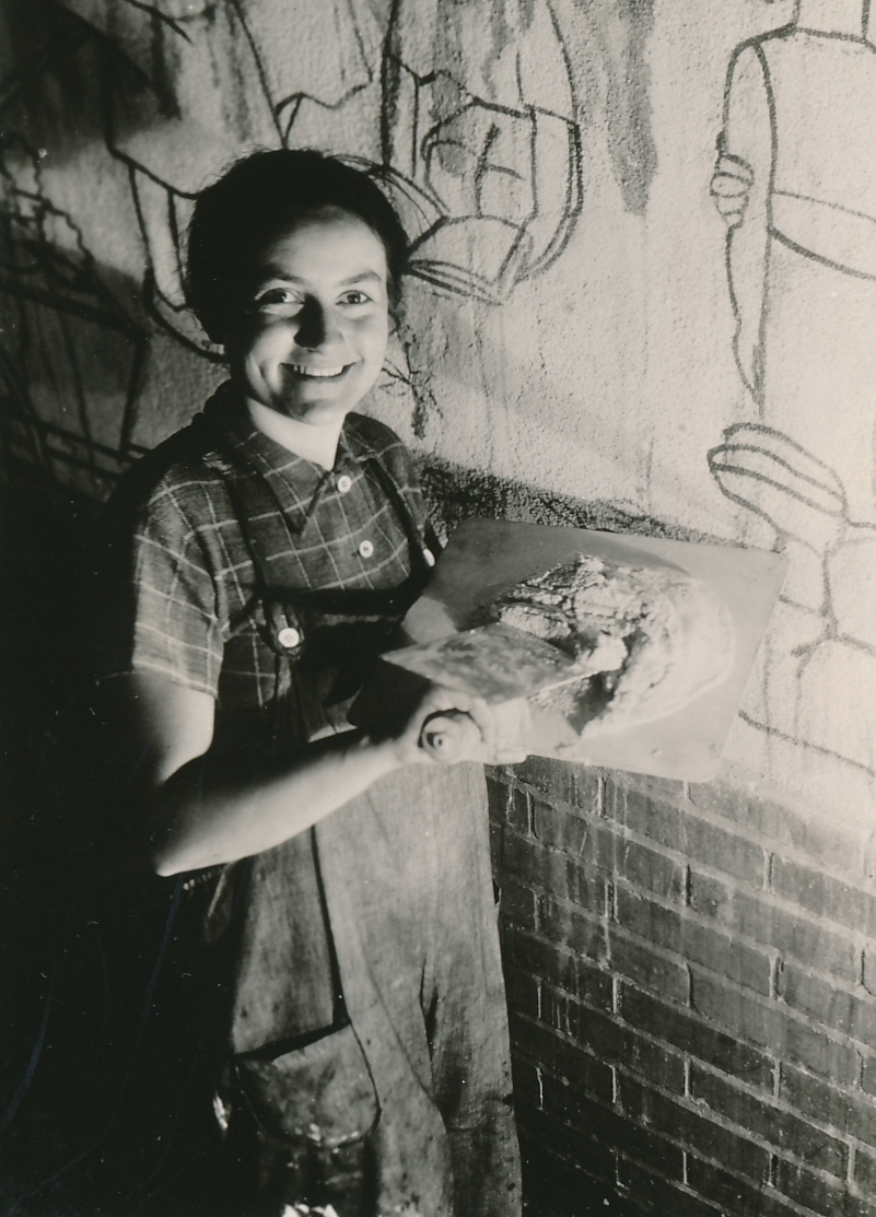 "WPA artist Lucienne Block is happy to create ""Cycle of a Woman's Life,"" a fresco mural at the House of Detention in New York City. Photo courtesy of the National Archives (ca. 1935-1943)."