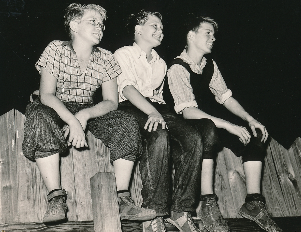 These young men are enjoying an outdoor performance of the WPA's Federal Theatre Project in New York City. Photo courtesy of the National Archives (ca. 1935-1939).