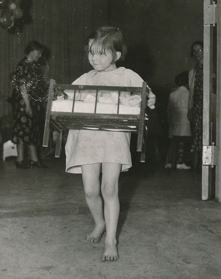 A new toy is always a good thing. A young girls leaves a WPA toy loan project in Atlanta, Georgia. Photo courtesy of the National Archives (May 1938).