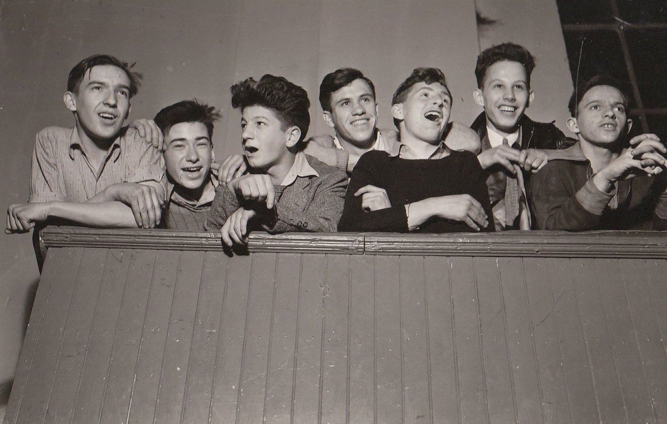 Young men happily singing folk songs at a WPA recreation center in Baltimore, Maryland. Photo courtesy of the National Archives (1938).
