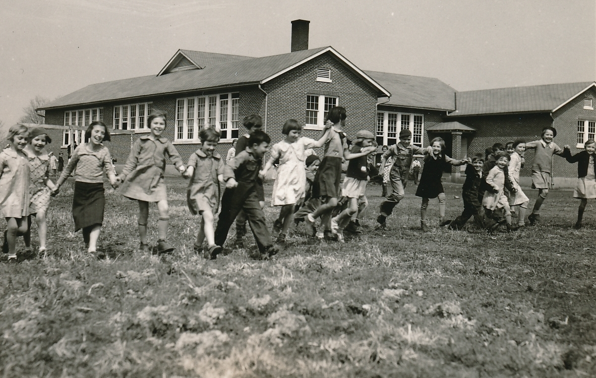 A WPA hot lunch is a recipe for happy schoolchildren in Lawrence County, Tennessee. Photo courtesy of the National Archives (1936).