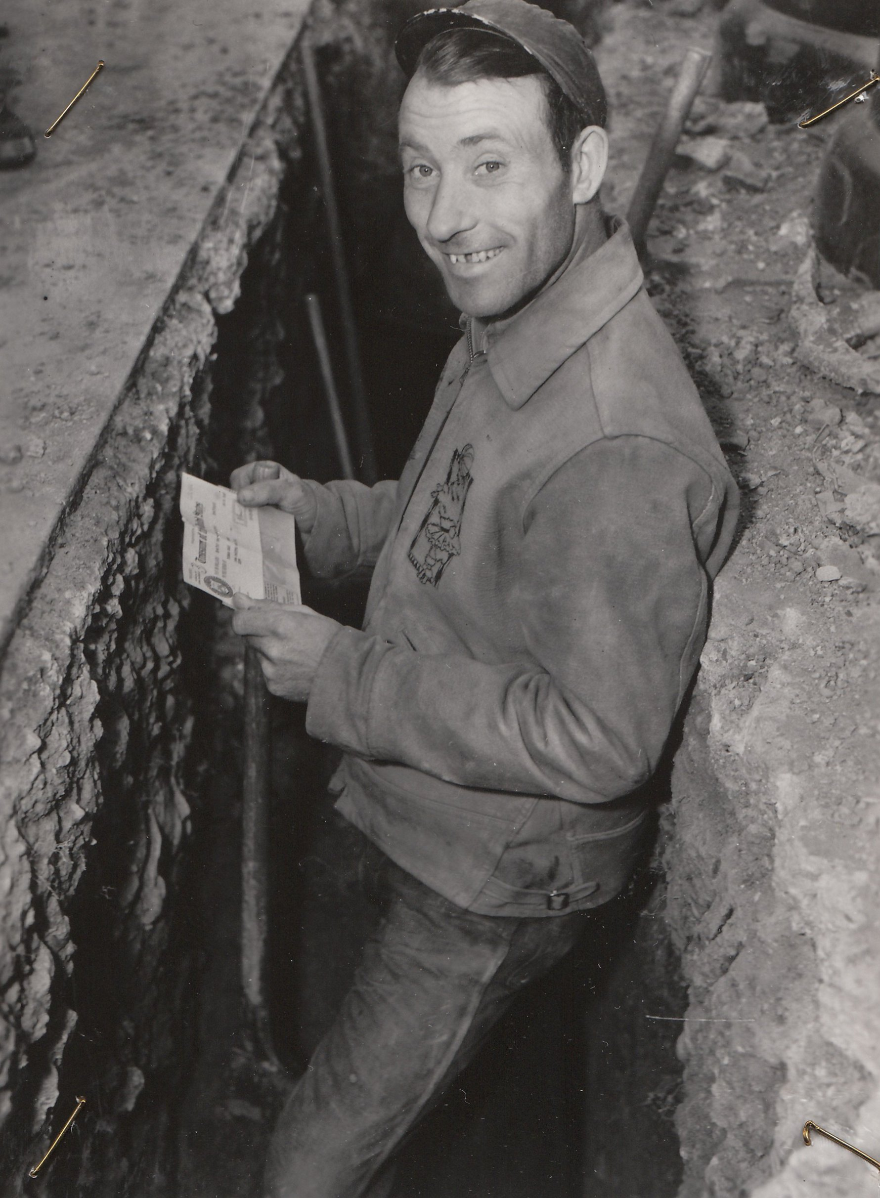 A WPA paycheck brings a smile in Washington, DC. Photo courtesy of the National Archives (January 1939).