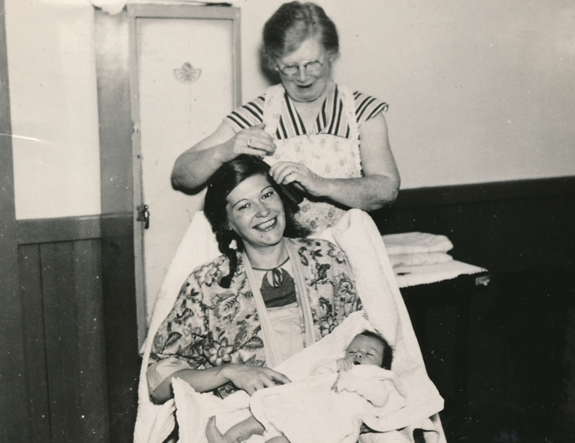 After giving birth and caring for a new baby, it's nice to get a little help from a WPA housekeeping aide in Brighton, Massachusetts. Photo courtesy of the National Archives (ca. 1935-1943).