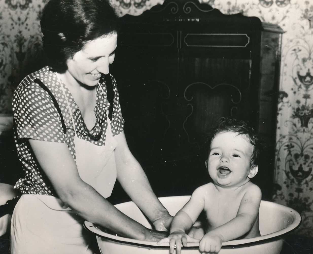 Bathing instructions, provided by a WPA nurse in New Orleans, meet with the approval of both mother and child. Photo courtesy of the National Archives (ca. 1935-1943).