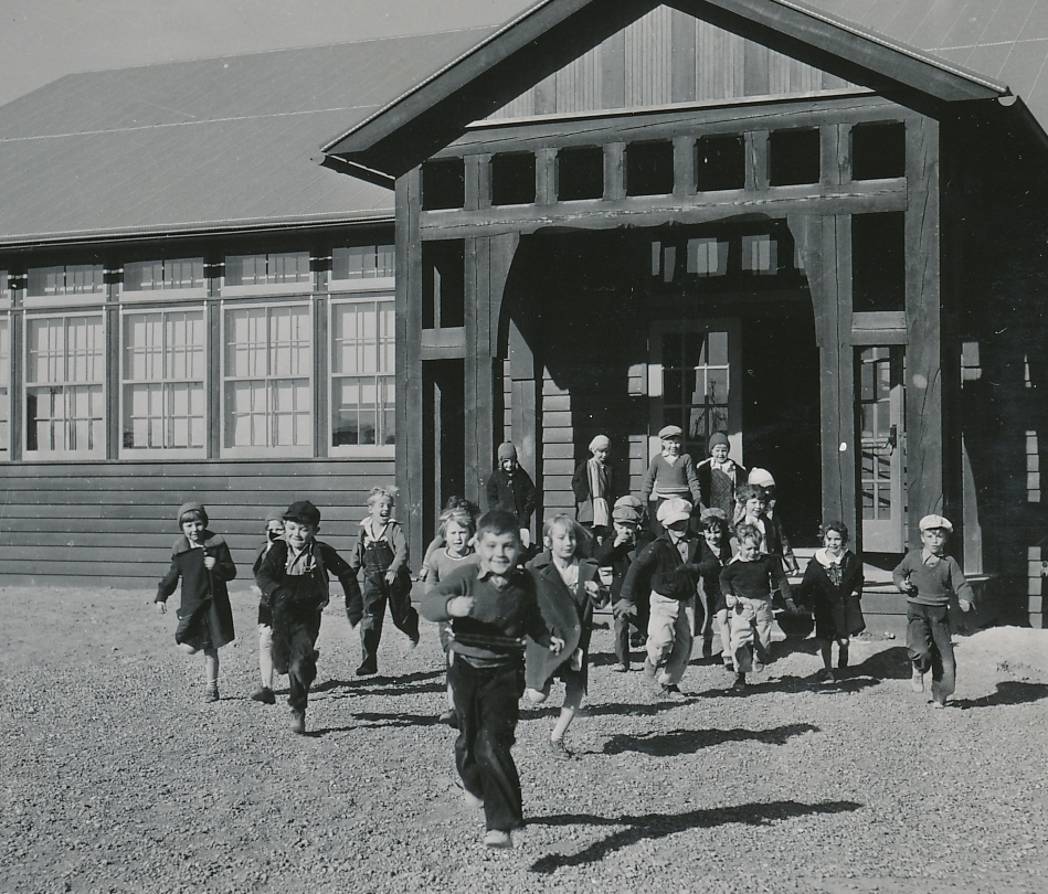 A brand new PWA-funded school in Fort Peck, Montana is nice; and so is the end of the school day! Photo courtesy of the National Archives (ca. 1935-1940).