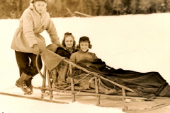 Two girls from Syracuse University enjoy a dog sled ride on a WPA-improved trail at Lake Placid, New York. Photo courtesy of the National Archives (ca. 1935-1943).