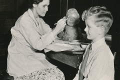 Artist, model, and sculpture all seem content with the WPA's recreation services in Washington State. Photo courtesy of the National Archives (1937).