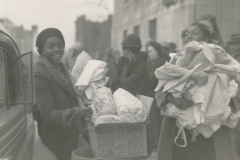WPA-supplied food and clothing brings a smile of relief in the aftermath of the deadly Gainesville Tornado of 1936 (Georgia). Photo courtesy of the National Archives (April 1936).