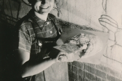 """WPA artist Lucienne Block is happy to create """"Cycle of a Woman's Life,"""" a fresco mural at the House of Detention in New York City. Photo courtesy of the National Archives (ca. 1935-1943)."""