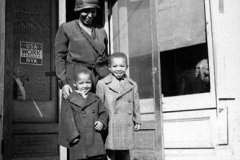 Two boys are happy to have new overcoats, from an NYA-run surplus commodities shop in Salem, Virginia. Photo courtesy of the National Archives and the New Deal Network (ca. 1935-1939).