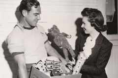 NYA workers Ray Schakel and Mary Weissker prepare to recondition and distribute donated toys to underprivileged children in Long Beach, California. Photo courtesy of the National Archives (ca. 1935-1943).