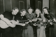 A guitar-playing quintet, part of a WPA music and recreation program in Prentice, Wisconsin. Photo courtesy of the National Archives (ca. 1935-1939).