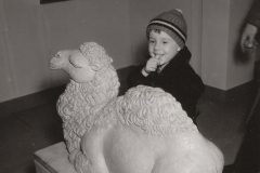 A young boy enjoys a children's art exhibit in Washington, DC, sponsored by the Federal Art Project. Photo courtesy of the National Archives (January 1938).