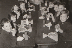 These young boys and girls are happy to have a WPA school lunch in Washington, DC. Photo courtesy of the National Archives (February 1938).