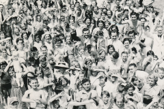 John Zimmerman (center, dark suit, waving), WPA director for recreation projects in Louisiana, celebrates Recreation Day in Algiers, Louisiana with an exuberant crowd. Photo courtesy of the National Archives (ca. 1935-1943).