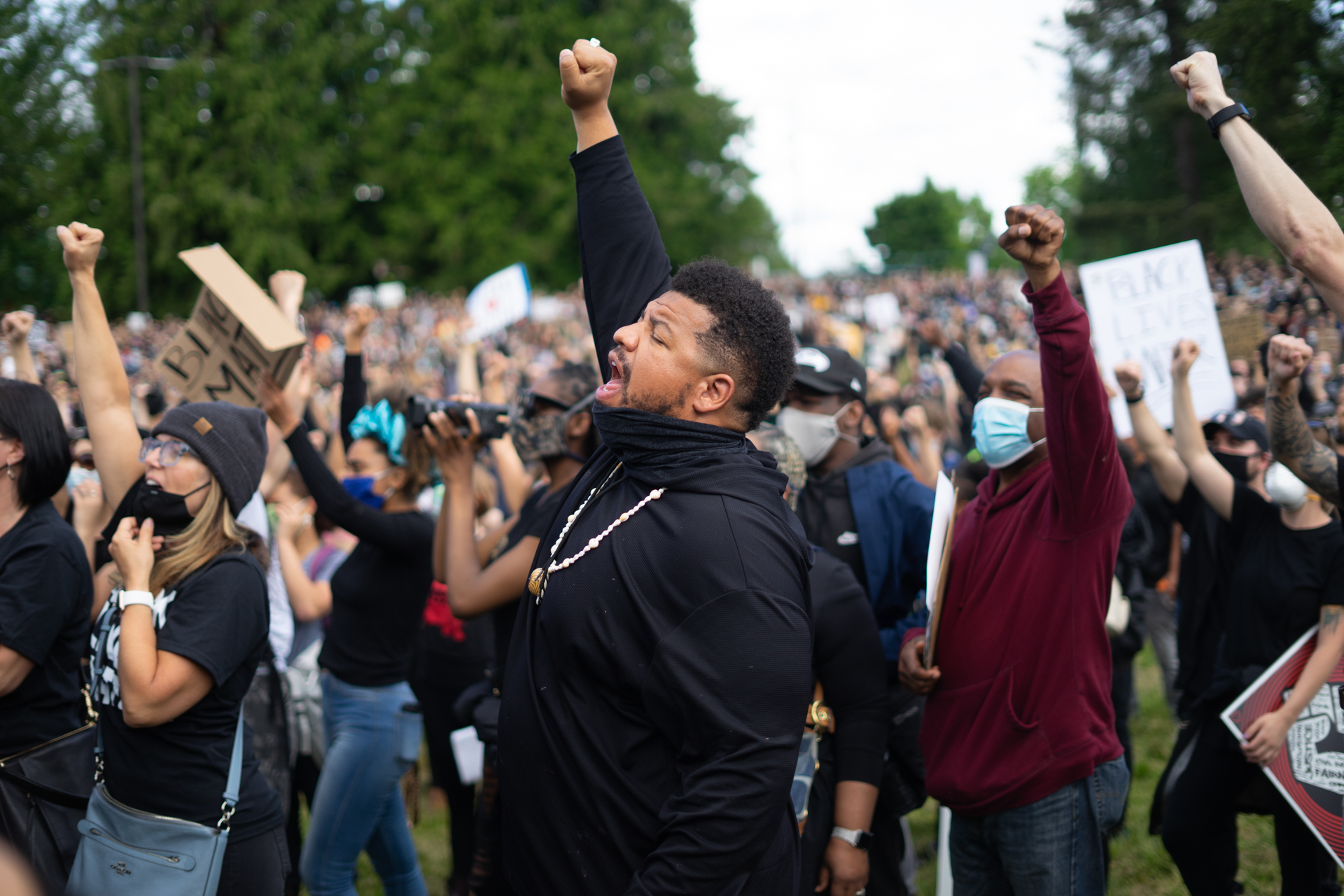Jordan Chaney raises his fist during a Black Lives Matter chant.