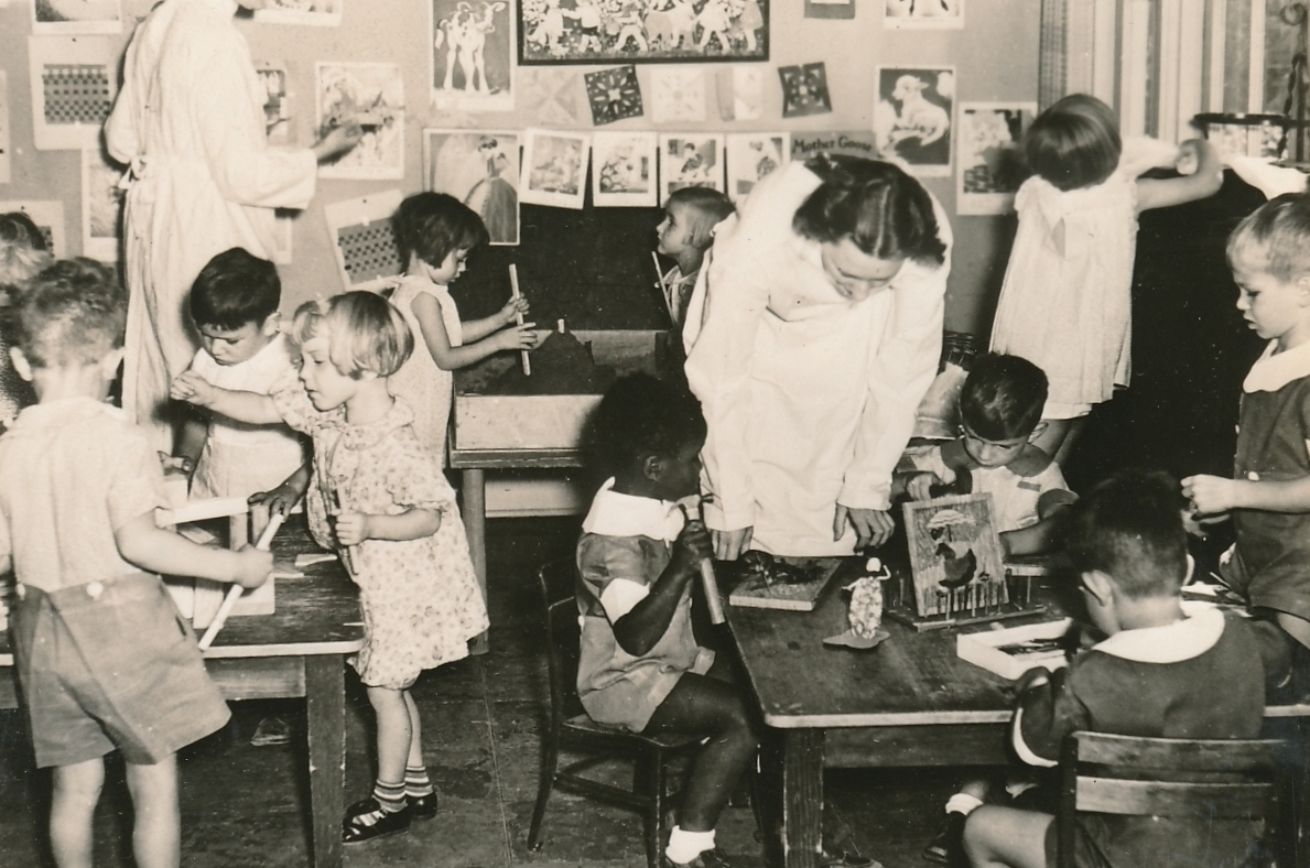 A children's play center in Oregon, supervised by a WPA worker. Photo courtesy of the National Archives (ca. 1935-1943).