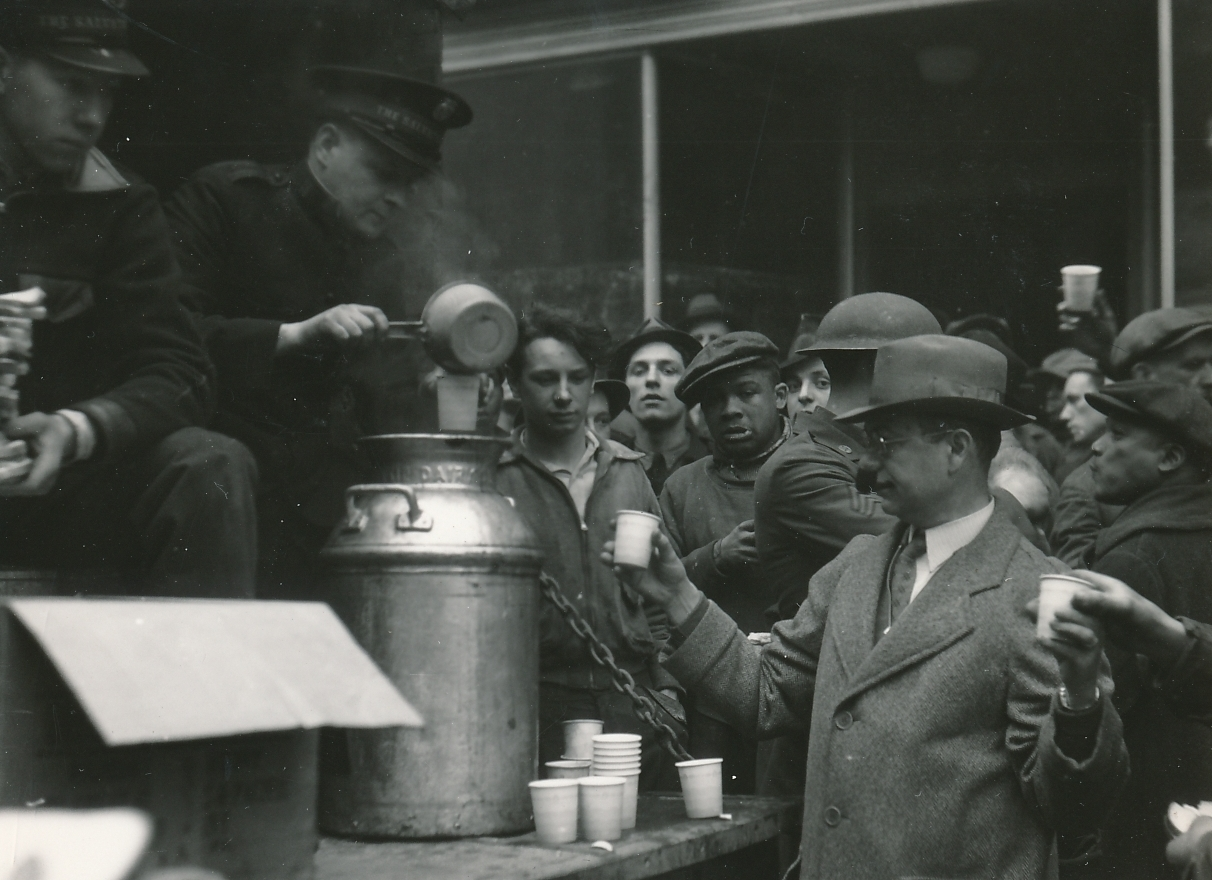Flood refugees and WPA workers in McKees Rock, Pennsylvania, receive coffee and sandwiches from the Salvation Army. Photo courtesy of the National Archives (1936).