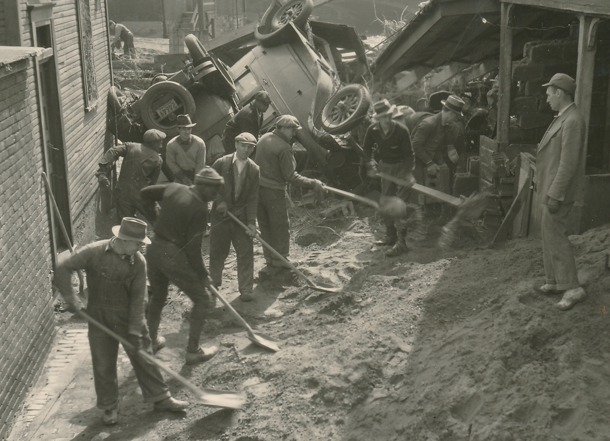 WPA workers cleaning up after a flood Johnstown, Pennsylvania. Photo courtesy of the National Archives (1936).