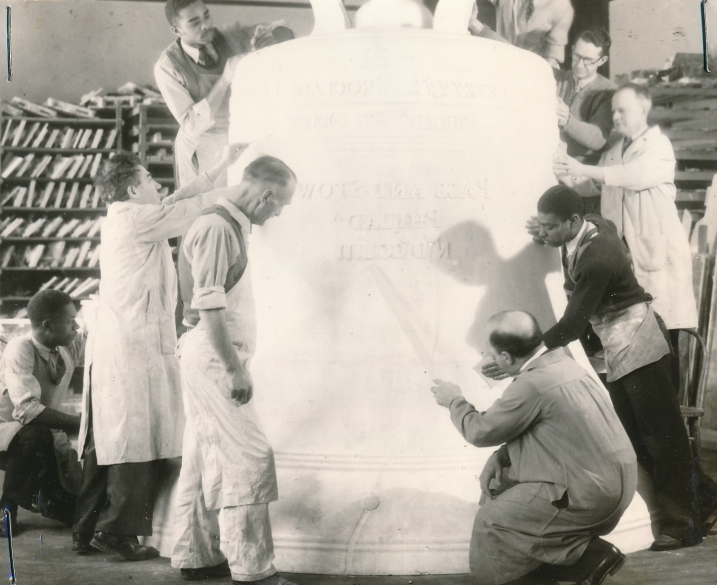 WPA and museum workers in Philadelphia, working on a replica of the Liberty Bell for a World's Fair exhibit. Photo courtesy of the National Archives (ca. 1939).
