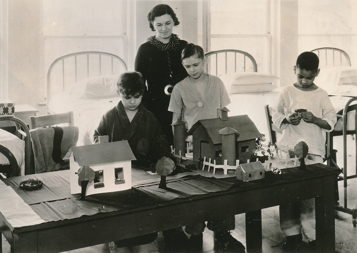 Young patients at the Lymanhurst Cardiac Clinic in Minnesota make a model farm during their convalescence, as part of a WPA handicraft project. Photo courtesy of the National Archives (ca. 1935-1943).