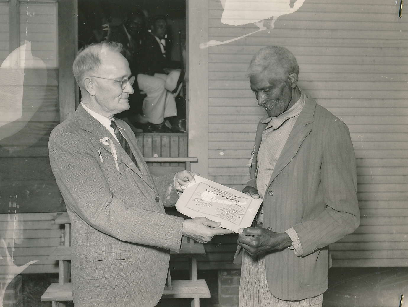 An African American student in Louisiana graduates from a WPA literacy class. Photo courtesy of the National Archives (ca. 1935-1943).