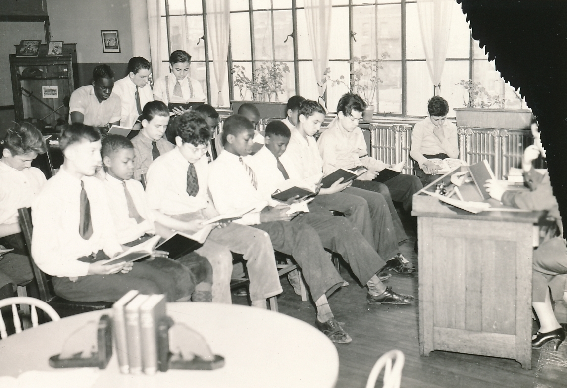 A remedial reading class at a WPA-operated library in Newark, New Jersey. Photo courtesy of the National Archives (April 1936).