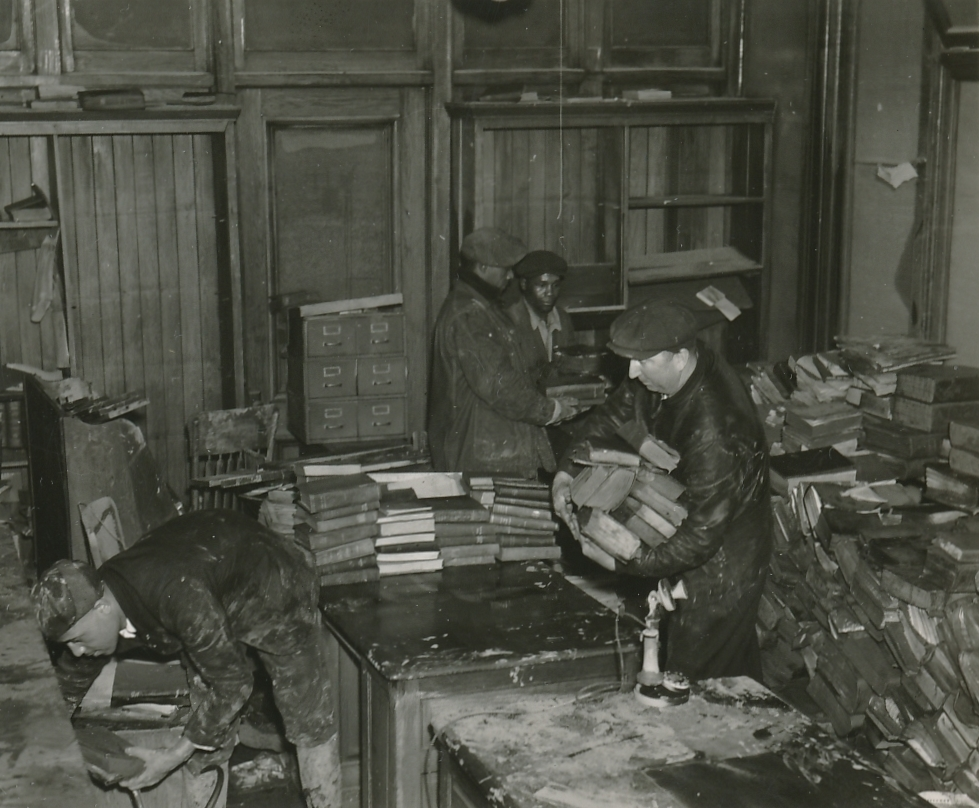 WPA workers cleaning out a flood-ravaged library in Louisville, Kentucky. Photo courtesy of the National Archives (February 1937).