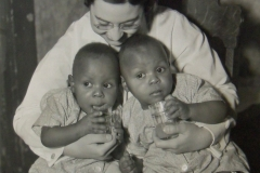 Twin babies at a nursery school or health clinic in Alabama, run by the Federal Emergency Relief Administration, ca. 1935. Photo courtesy of the National Archives.