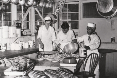 Two NYA workers and a chef prepare meals for other NYA workers at the Los Angeles City Playground and Recreation Center Project, April 8, 1941. Photo courtesy of the National Archives.