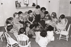 NYA student worker Antoinette Lee reads to children at the 28th St. School nursery, Los Angeles, California, January 30, 1941. Photo courtesy of the National Archives.