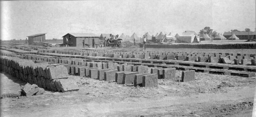 Adobe bricks being dried for warden's residence, 1934.  Tents of CCC Company 1958 visible in the background (Engbeck 2002).