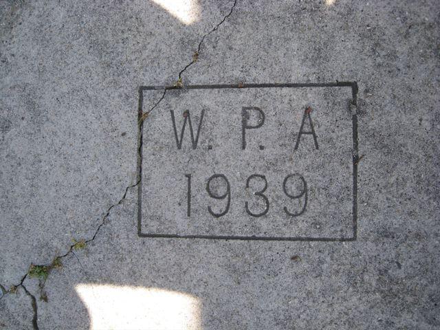 Closeup of Albany sidewalk stamp at the corner of Santa Fe and Francis