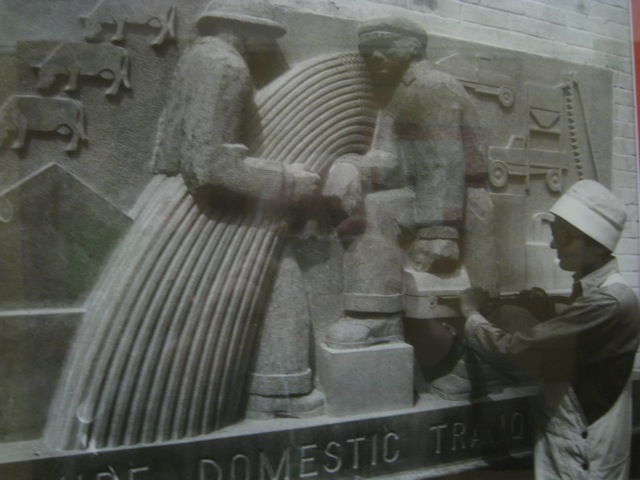 WPA artist Lenore Thomas carving reliefs illustrating preamble to U.S. Constitution