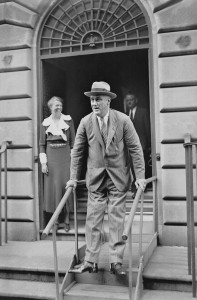 With the help of special supports, President Roosevelt leaves his home at 65th Street in New York City.  September 1933