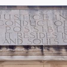 Inscription on Dept of Justice building - Washington DC