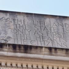 Inscription on front of Dept of Justice building - Washington DC