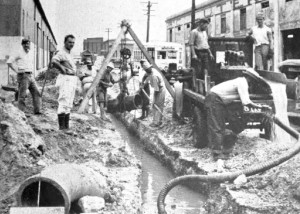 New Deal workers dig a water line in San Juan.