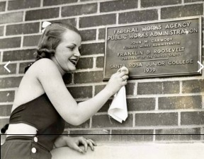 Polishing a plaque on a Santa Rosa Junior College building