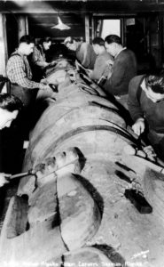 CCC men restore a totem pole in Saxman, 1939