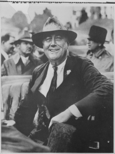 FDR smiling, wearing a hat