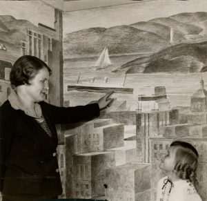 Suzanne Scheuer showing new frescos to Enid Henley on Enid's nursery school walls, 1933.