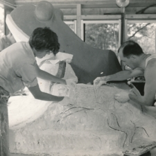 Artists Joseph Goethe (behind sculpture), Lenore Thomas, Carmelo Aruta, and Hugh Collins working on frog sculpture for Langston Terrace - Washington DC