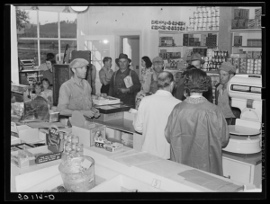 Buying groceries in community store, 1938