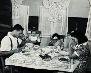 A family says grace before dinner, Anacostia Housing Project, 1942