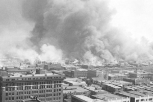Black Wall Street Ablaze, 1921—The first bombs ever dropped on American soil fell on the Greenwood neighborhood of Tulsa, OK.