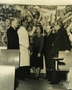 Viewing murals at Toland Hall at UCSF, left to right: F. Stanley Durie, Superintendent of UC Hospital, Dr. William E. Carter, Phyllis Wrightson, Joseph Allen, State Director of WPA Federal Art Project, Bernard Zakheim (ca. 1939)